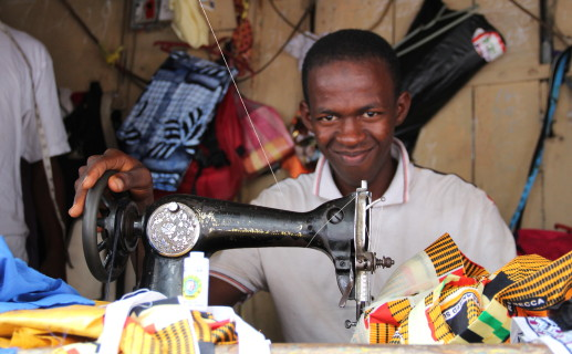 """Before I visited the YMCA it was a real struggle looking for work on the street. With the money I get from the tailoring I can now help support my family."" Emanuel, 16, tailoring trainee, Sierra Leone. Photo: Amy Russell/YCI"