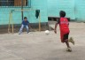 Two boys in Guatemala play football
