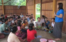 A YMCA peer educator shares newly learned knowledge on voter rights ahead of Myanmar general elections on November 8 2015.