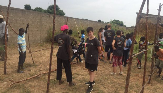 Members of Daba and Jemma's team build a new classroom at a school. Photo: Kyle Casey